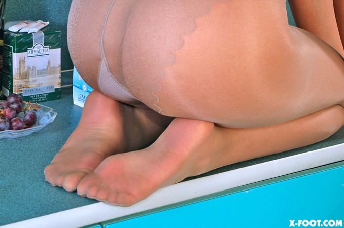 Young feet in pantyhose